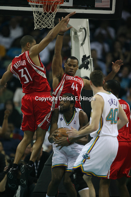 Melvin Ely looks to put up a shot as Shane Battier #31 and Chuck Hayes #44 defend for the Houston Rockets on February 22, 2008 at the New Orleans Arena in New Orleans, Louisiana. The New Orleans Hornets lost to the Houston Rockets 100-80.