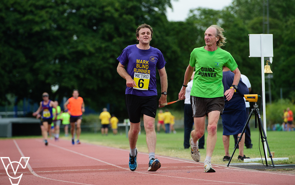 Event: 5000 meter relay<br /> Competitors, from left: Mark Ellis<br /> <br /> Metro Blind Sport's 42nd Athletics Open, held at Mile End Stadium, Tower Hamlets, London.<br /> <br /> Picture: Chris Vaughan Photography for Metro Blind Sports<br /> Date: June 16, 2018
