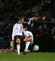 Photo: Andrew Unwin.<br />Scotland v USA. International Challenge. 12/11/2005.<br />Scotland's James McFadden (R) holds off the USA's Christopher Rolfe (L).