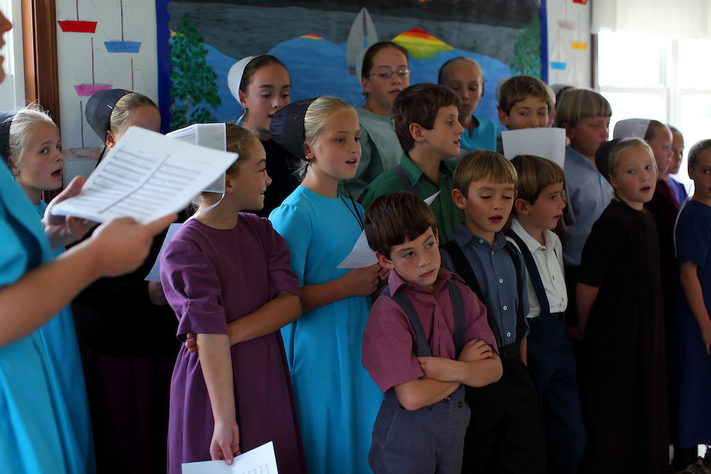 Amish children gather at a one-room schoolhouse in Berlin, Ohio, Oct. 12, 2009.