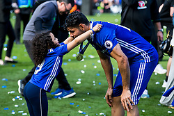 Diego Costa and his daughter play around with his winners medal as Chelsea celebrate winning the 2016/17 Premier League - Rogan Thomson/JMP - 21/05/2017 - FOOTBALL - Stamford Bridge - London, England - Chelsea v Sunderland - Premier League..