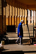 A carpenter goes back to his work area in this hallway of the Ville Nouvelle in Fes, Morocco on Wednesday evening, May 30, 2007. (PHOTO BY TIMOTHY  D. BURDICK)