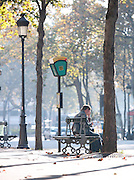 People sitting at a bus stop in Paris, France