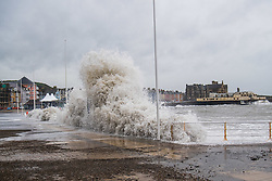© Licensed to London News Pictures. 3/02/2017. Aberystwyth, Wales, UK. High tides and a strong Atlantic swell this morning bring huge waves crashing into the promenade and sea defences in Aberystwyth on the west Wales coast. Potentially damaging gales, with gusts in excess of 60mph are forecast to strike parts of the UK today. Photo credit: Keith Morris/LNP