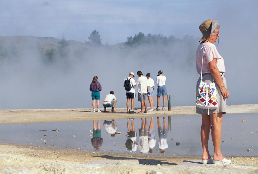 New Zealand, North Island, Tourist walk through Waiotapu Thermal Reserve south of Rotorua.