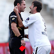 Referee's Halis Ozkahya with istanbul BBSK's Metin Depe during their Turkish Superleague soccer match istanbul BBSK between Orduspor at the Ataturk Olympic stadium in Istanbul Turkey on Sunday 23 September 2012. Photo by TURKPIX