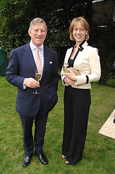 MAJOR GENERAL ARTHUR DENARO former Commandment of The Royal Military Academy Sandhurst and ARABELLA WINDHAM at a reception for the Friends of The Castle of Mey held at The Goring Hotel, London on 20th May 2008.<br />