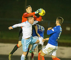 Cowdenbeath's keeper David McGurn over Forfar Athletic's David Cox. Cowdenbeath 3 v 4 Forfar Athletic, Scottish Football League Division Two game played 17/12/2016 at Central Park.