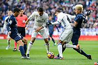 Real Madrid's Carlos Henrique Casemiro and Raphael Varane and Malaga CF's Adalberto Peñaranda Maestre during La Liga match between Real Madrid and Malaga CF at Santiago Bernabeu Stadium in Madrid, Spain. January 21, 2017. (ALTERPHOTOS/BorjaB.Hojas)