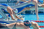 Lindsay Benko hasn't even left the start as her competition reaches for the pool in the women's 100-meter freestyle preliminary at the U.S. Olympic Swim Trials in Long Beach, California.