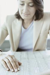 Dec. 05, 2012 - Businesswoman reading stocks and shares (Credit Image: © Image Source/ZUMAPRESS.com)