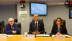U.S. President Barack Obama makes a statement after receiving a briefing on Hurricane Matthew at the Federal Emergency Management Agency(FEMA) in Washington DC, October 5, 2016. Seated is FEMA Administrator Craig Fugate(left) and Lisa Monaco, U.S. Homeland Security Advisor to President Obama(right). Photo/ Chris Kleponis/Abaca