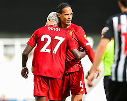 LIVERPOOL, ENGLAND - Sunday, July 26, 2020: Divock Origi (L) celebrates scoring the second goal with team-mate Virgil van Dijk during the final match of the FA Premier League season between Newcastle United FC and Liverpool FC at St. James' Park. The game was played behind closed doors due to the UK government's social distancing laws during the Coronavirus COVID-19 Pandemic. Liverpool won 3-1 and finished the season as Champions on 99 points. (Pic by Propaganda)