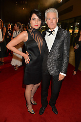 MARIANA DE CARVALHO and ADAM CLAYTON at the GQ Men of The Year Awards 2016 in association with Hugo Boss held at Tate Modern, London on 6th September 2016.