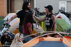 Blake Hudson and friends in the makeshift downtown campground during the Run to Raton. Raton, NM. USA. Saturday July 21, 2018. Photography ©2018 Michael Lichter.