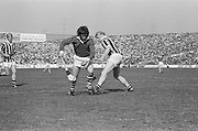 Kilkenny player attempts to trip Cork player who has possession of the slitor during at the All Ireland Senior Hurling Final, Cork v Kilkenny in Croke Park on the 3rd September 1972. Kilkenny 3-24, Cork 5-11.