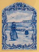 Traditional Painted Ceramic Tiles panel representing a fisherman's wife and child on the beach of Nazare, Portugal
