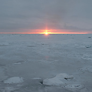 Sunset over the newly forming ice of the Arctic Ocean.