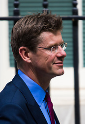 Downing Street, London, May 12th 2015. The all-conservatives Cabinet ministers gather for their first official meeting at Downing Street. PICTURED: Communities Secretary Greg Clark