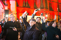 "© Licensed to London News Pictures . 03/02/2015 . Manchester , UK . People in the crowd raise their phones with the lights on , as part of the campaign , at the demonstration . Demonstration organised by the Labour Party on the steps of Manchester City Council in Albert Sqaure , Manchester , under the banner ""manVcam"" ( Manchester vs Cameron ) . Organisers say Manchester - along with Liverpool and Birmingham - have suffered larger cuts than other regional authorities , whilst southern regions such as Surrey , Hampshire and West Sussex have all seen increases in government funding . Photo credit : Joel Goodman/LNP"