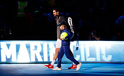 Marin Cilic walks onto court before the start of his match against Jack Sock during day three of the NITTO ATP World Tour Finals at the O2 Arena, London.