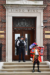 A town crier outside the Lindo Wing at St Mary's Hospital in Paddington, London, after the news that the Duchess of Cambridge has given birth to a son.