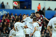 Aston Villa's Ciaran Clark challenges Swansea's Bafetimbi Gomis at a corner. Barclays Premier league match, Swansea city v Aston Villa at the Liberty Stadium in Swansea, South Wales on Saturday 19th March 2016.<br /> pic by  Carl Robertson, Andrew Orchard sports photography.