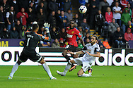 Man Utd's Danny Welbeck shoots and scores his sides 4th goal past Swans keeper Michel Vorm . Barclays Premier league, Swansea city v Manchester Utd in Swansea, South Wales on Saturday 17th August 2013. pic by Andrew Orchard ,Andrew Orchard sports photography,