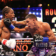 WINTER PARK, FL - AUGUST 02: Juan Carlos Payano (R) fights against Rau'shee Warren during the Premier Boxing Champions on Bounce TV boxing match at Full Sail University - Ebbs Auditorium on August 2, 2015 in Winter Park, Florida. Payano won the bout and retained his WBA and IBO  bantamweight title. (Photo by Alex Menendez/Getty Images) *** Local Caption *** Juan Carlos Payano; Rau'shee Warren