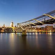 Millenium Bridge and London skyline at night