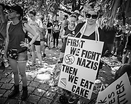"""New Orleans, Aug 19, 2017,  People at a rally held by """"Take Em Down NOLA"""" held  in solidarity with Charlottesville in Armstrong Park's Congo Square before marching through the French Quarter."""