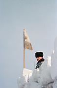 Secutity guard watches over The Farewell to Winter Festival, Listvyanka, Siberia, Russia