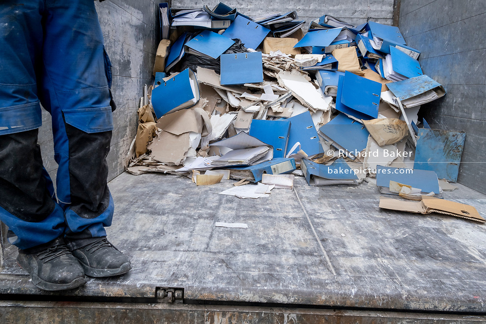 Plasterboard and ring-binders, some containing confidential data and indormation are in the back of the lorry of an office clearance contractor in the West End, on 29th April 2021, in London, England.