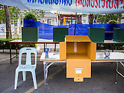 30 MARCH 2014 - BANGKOK, THAILAND:    A polling place ready to open at Wat That Thong in Bangkok. Thais voted Sunday to elect 77 senators to the 150-seat Senate. The other 73 senators are appointed by judges and senior officials from agencies such as the National Anti-Corruption Commission (NACC), members of an establishment whom government supporters see as viscerally anti-Thaksin. The government of Yingluck Shinawatra tried to make the senate a fully elected body. That effort was one of the sparks that set off the latest rounds unrest that started in November.   PHOTO BY JACK KURTZ