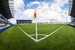 The corner flag at the TheFalkirk Stadium, with the new pitch work for the Scottish Championship game v Morton. The woven GreenFields MX synthetic turf and the surface has been specifically designed for football with 50mm tufts compared with the longer 65mm which has been used for mixed football and rugby uses.  It is fully FFA two star compliant and conforms to rules laid out by the SPL and SFL.<br /> ©Michael Schofield.