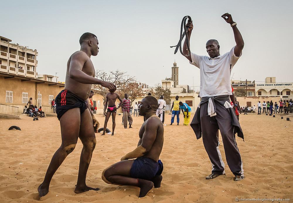 Ex Wrestler Lac de Guiers instructs you wrestlers at his wrestling school in Dakar, Senegal.