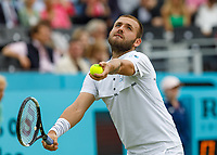 Tennis - 2019 Queen's Club Fever-Tree Championships - Day Three, Wednesday<br /> <br /> Men's Singles, First Round: Daniel Evans (GBR) Vs. Stan Wawrinka (SWI)<br /> <br /> Daniel Evans (GBR) serves before rain stopped play on Centre Court.<br />  <br /> COLORSPORT/DANIEL BEARHAM