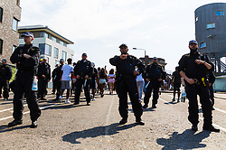 A heavy police presence helps ensure violent or drug related incidents are kept to a minimum, with riot police manning metal detectors and singling out members of the crowd for searches on all approaches to the carnival as day one, Children's Day, of the Notting Hill Carnival gets underway in London. London, August 25 2019.