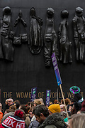 Passing the Women of World war 2 memorial In Whitehall - #March4Women 2018, a march and rally in London to celebrate International Women's Day and 100 years since the first women in the UK gained the right to vote.  Organised by Care International the march stated at Old Palace Yard and ended in a rally in Trafalgar Square.