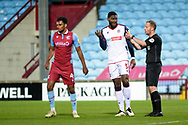 Referee Martin Coy discussing with Bolton Wanderers Ricardo Santos (5) during the EFL Sky Bet League 2 match between Scunthorpe United and Bolton Wanderers at the Sands Venue Stadium, Scunthorpe, England on 24 November 2020.
