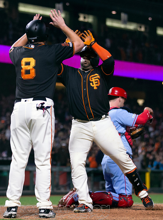 Jul 6, 2019; San Francisco, CA, USA; San Francisco Giants third baseman Pablo Sandoval, right, and teammate Alex Dickerson (8) celebrate a two-run home run by Sandoval against the St. Louis Cardinals during the seventh inning of a baseball game at Oracle Park. Mandatory Credit: D. Ross Cameron-USA TODAY Sports