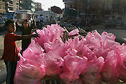 Pink plastic bags of bread on a busy street in Cairo, Egypt.