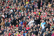 Middlesbrough fans in santa hats during the Sky Bet Championship match between Brighton and Hove Albion and Middlesbrough at the American Express Community Stadium, Brighton and Hove, England on 19 December 2015.