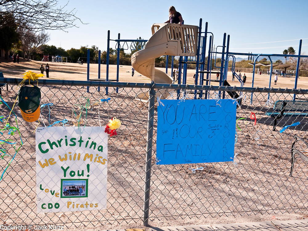 tucsonshooting - 10 JANUARY 2011 - ORO VALLEY, AZ: School mates of Christina Green on the playground at Mesa Verde Elementary School in Oro Valley. Christina Green was a student at the school, and was one of the people murdered Saturday in the mass shooting in Tucson.  ARIZONA REPUBLIC PHOTO BY JACK KURTZ..Gabrielle Giffords shooting