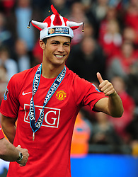 Jun 11, 2009 - Manchester, UK - Manchester United have accepted a world record offer of 30 million from Real Madrid for winger CRISTIANO RONALDO. The decision came at the 24-year-old Ronaldo's request after he 'again expressed his desire to leave'. United said the offer was unconditional and want the matter to be concluded by June 30, while Madrid hope to agree personal terms 'in the next few days'. Real Madrid confirm they have made an offer to Manchester United for the acquisition of the rights of the player Cristiano Ronaldo. PICTURED: May 16, 2009 Cristiano Ronaldo of Manchester United who was nicknamed the winker after World Cup 2006 enjoys holding the Premier League Trophy. Manchester United v Arsenal. (Credit Image: © Simon Bellis/Cal Sport Media/ZUMA Press)