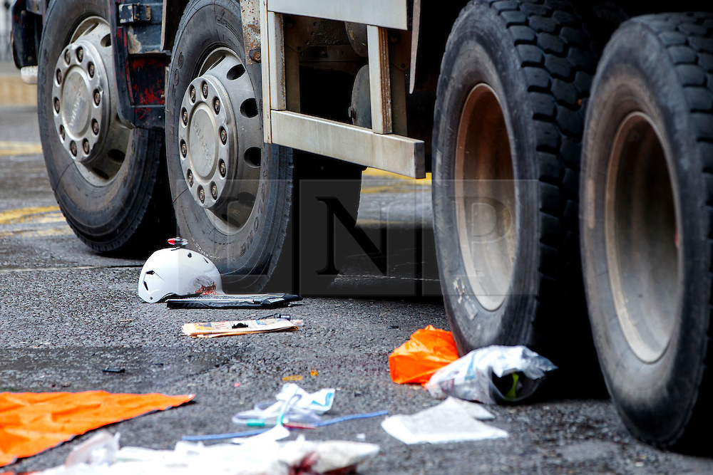 © Licensed to London News Pictures. 22/06/2015. London, UK. Helmet of a female cyclist who died in a crash with a tipper truck at Bank junction in London during morning rush hour on Monday, June 22, 2015. Photo credit: Tolga Akmen/LNP