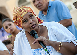 August 28, 2017 - Rome, Italy - Gemma Vecchi, president of Casa Africa Onlus, the woman who had been hit full by the idran on the day of leaving the Independence Square and had fallen losing her senses. He has been out of the hospital for some days where he has given him 30 days of prognosis. During the assembly in Piazza Venezia it intervened bringing its solidarity and showed the bruises it has throughout the body (Credit Image: © Patrizia Cortellessa/Pacific Press via ZUMA Wire)
