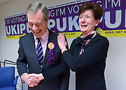 © Licensed to London News Pictures. 12/02/2013. Eastleigh, UK NIGEL FARAGE (L) and DIANE JAMES. Diane James, chosen yesterday to fight the Eastleigh by election for UKIP, campaigns with Nigel Farage, leader of the party, in Easleigh's Market Street today 12th February 2013. Photo credit : Stephen Simpson/LNP
