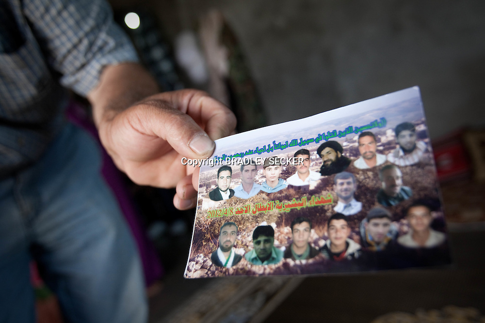 A photograph shows the fifteen men and children killed when the Syrian military attacked the village of Basheria, Idlib on April 22nd 2012. 14/06/2012