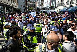 London, UK. 10th June, 2018. Police move on a man who shouted towards members of far-right groups protesting against the pro-Palestinian Al Quds Day march through central London organised by the Islamic Human Rights Commission. An international event, it began in Iran in 1979. Quds is the Arabic name for Jerusalem.